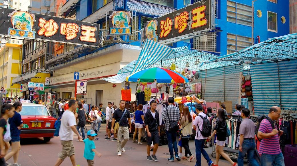 女人街 呈现出 市場 和 指示牌 以及 一大群人