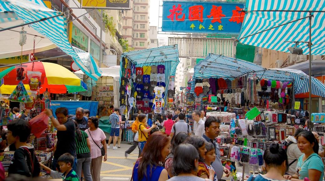 女人街 设有 市場 和 指示牌 以及 一大群人