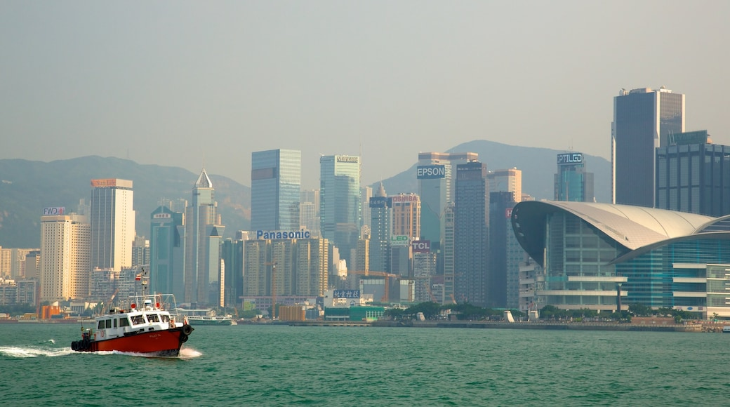Victoria Harbour showing skyline, a city and boating