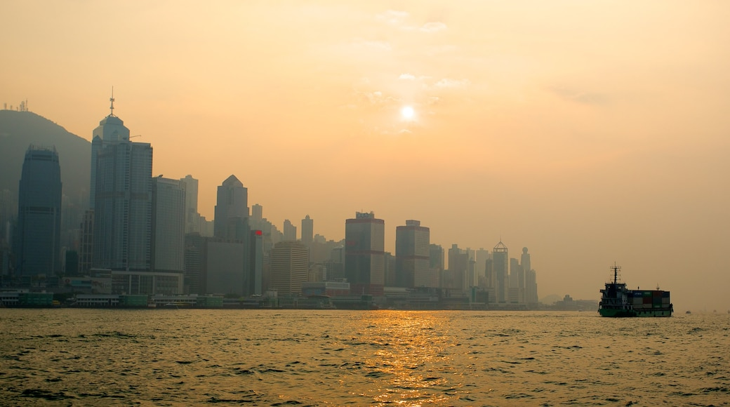 Victoria Harbour which includes skyline, boating and modern architecture