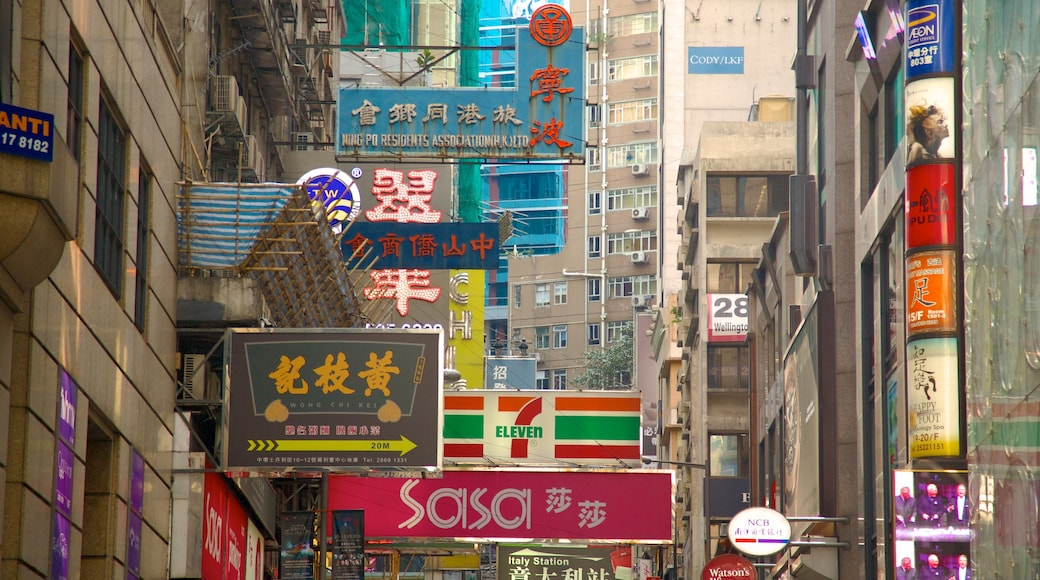 Lan Kwai Fong showing signage and a city
