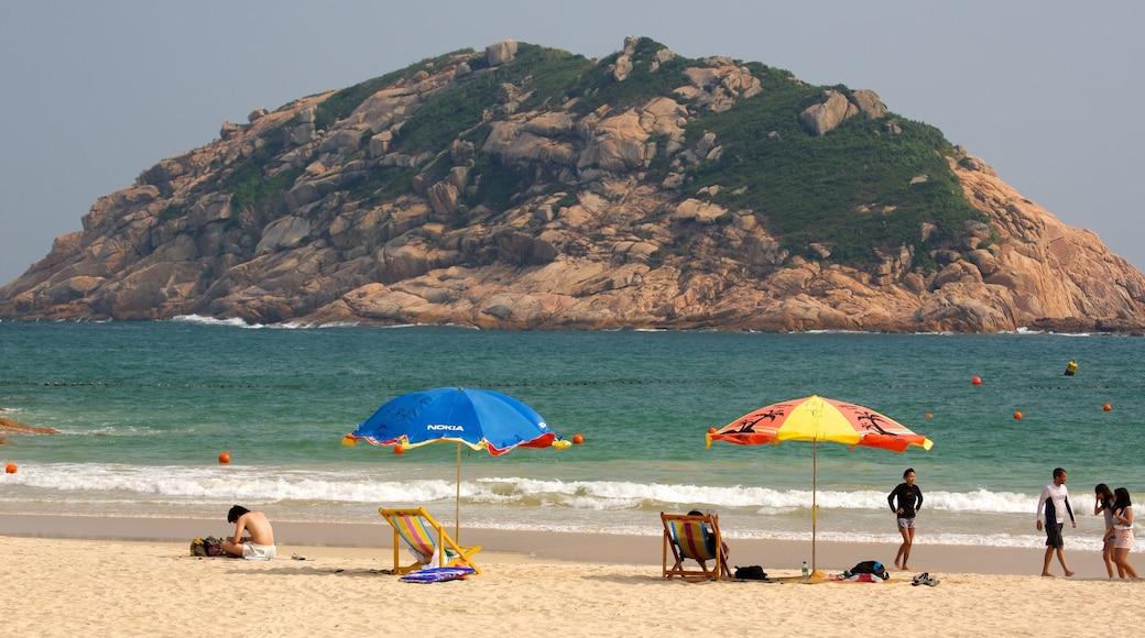Shek O Beach which includes a beach and general coastal views