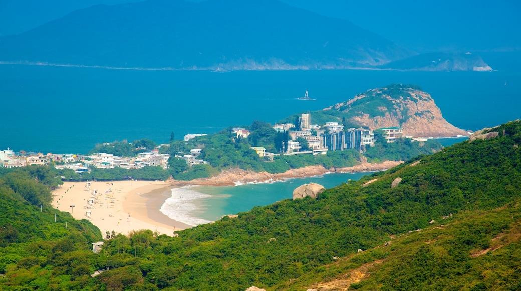 Shek O Beach which includes a beach, a coastal town and mountains