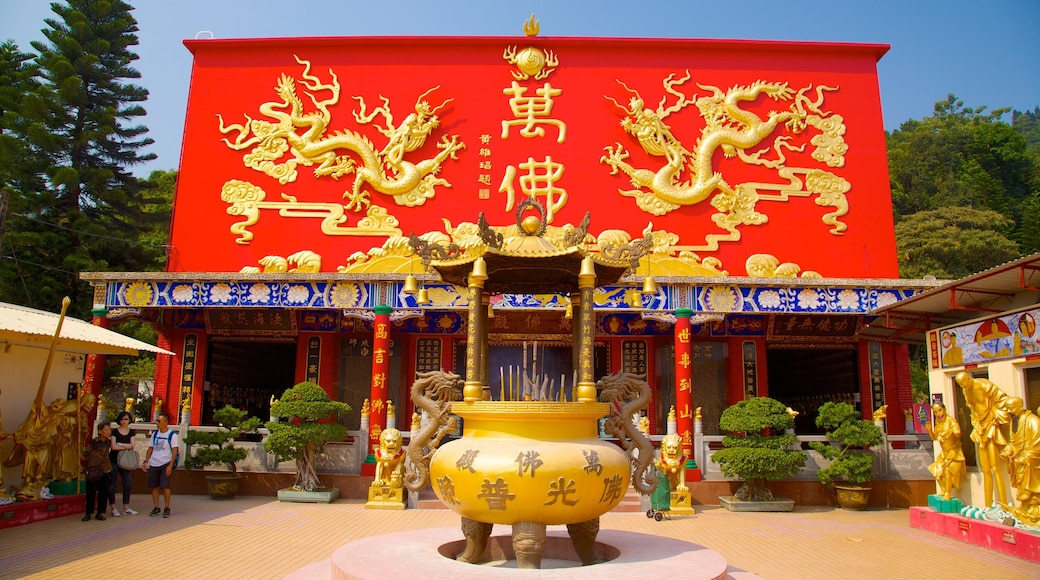 Ten Thousand Buddhas Monastery which includes a temple or place of worship and religious aspects