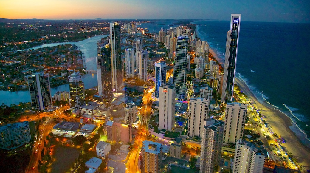 SkyPoint Observation Deck which includes a city, cbd and night scenes