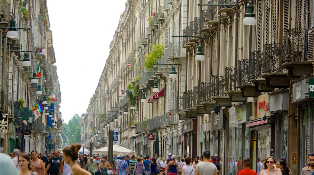 Turin which includes a city and street scenes as well as a large group of people