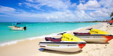 Cable Beach which includes tropical scenes, a sandy beach and jet skiing