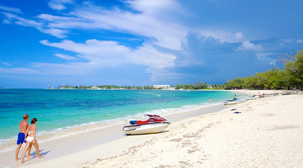 Cable Beach featuring a sandy beach, tropical scenes and jet skiing