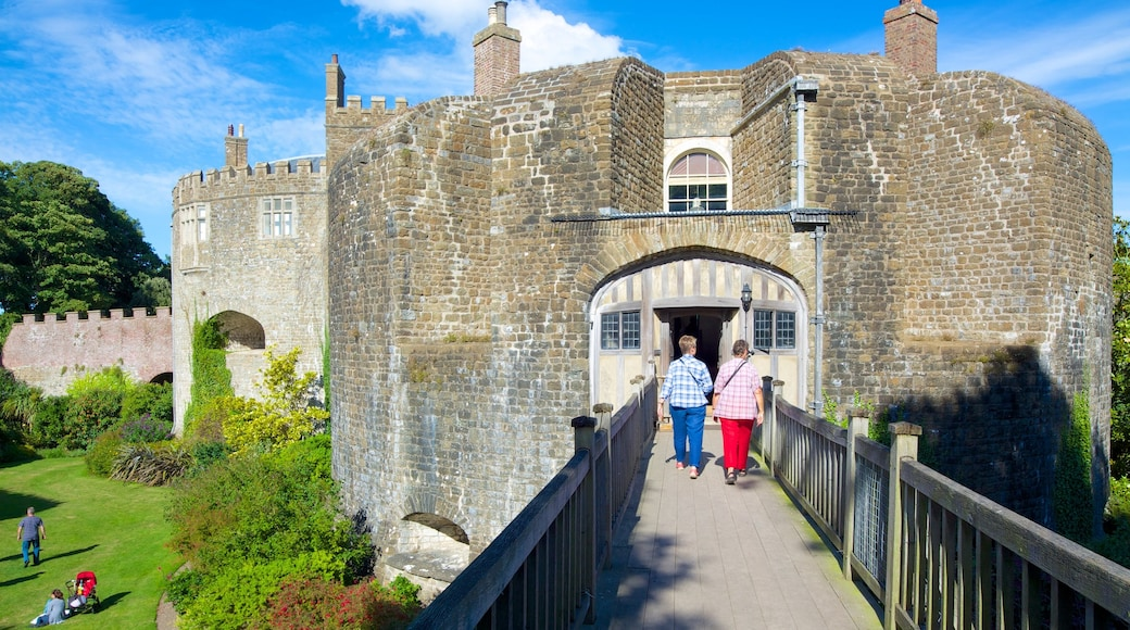 Walmer Castle and Gardens which includes chateau or palace and a bridge as well as a small group of people
