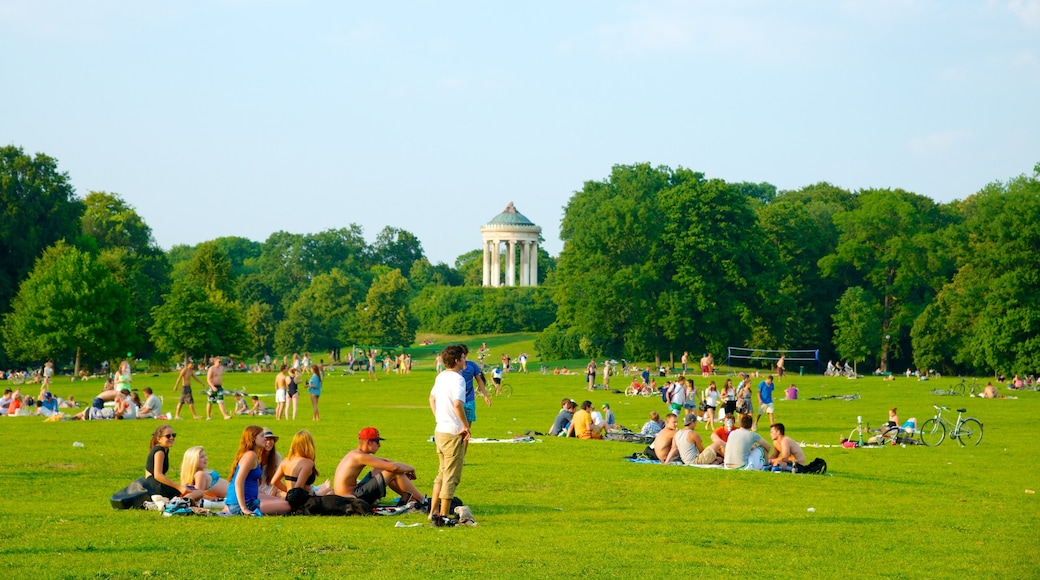 English Garden which includes a garden and a city as well as a large group of people
