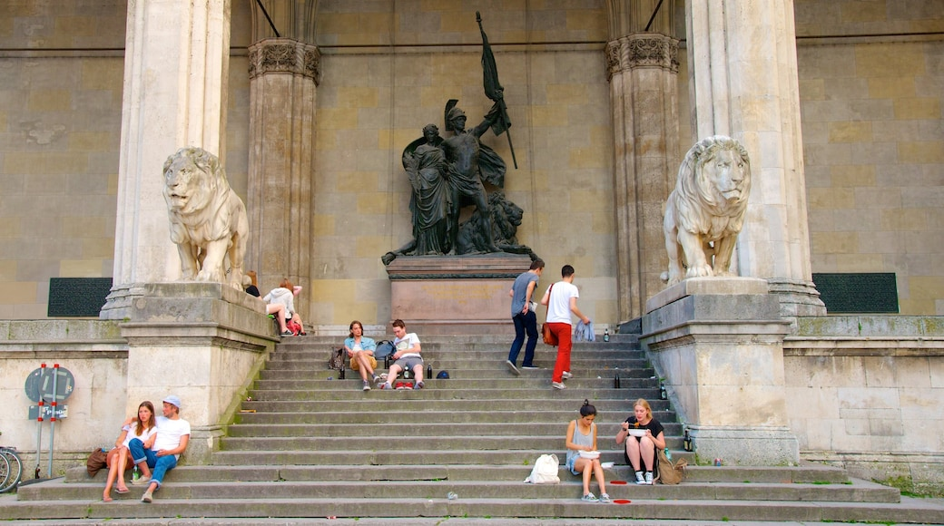 Odeonsplatz which includes a statue or sculpture, heritage architecture and street scenes