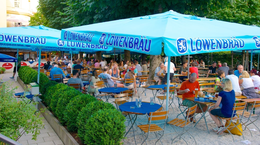 Lowenbrau showing outdoor eating, a city and street scenes