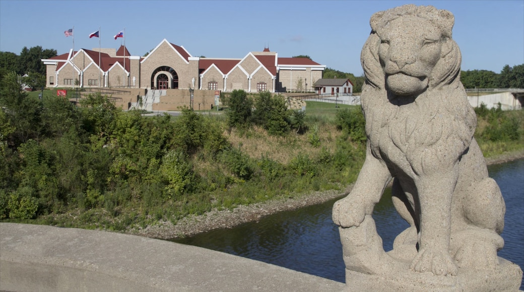 Cedar Rapids which includes a small town or village, a statue or sculpture and a river or creek