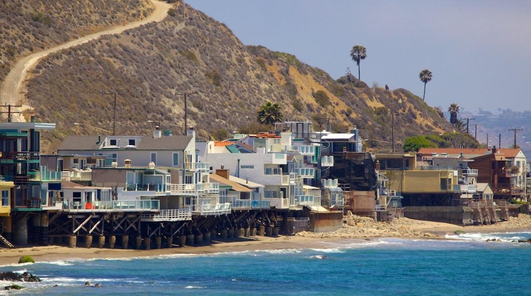 Malibu showing a house, a coastal town and a sandy beach