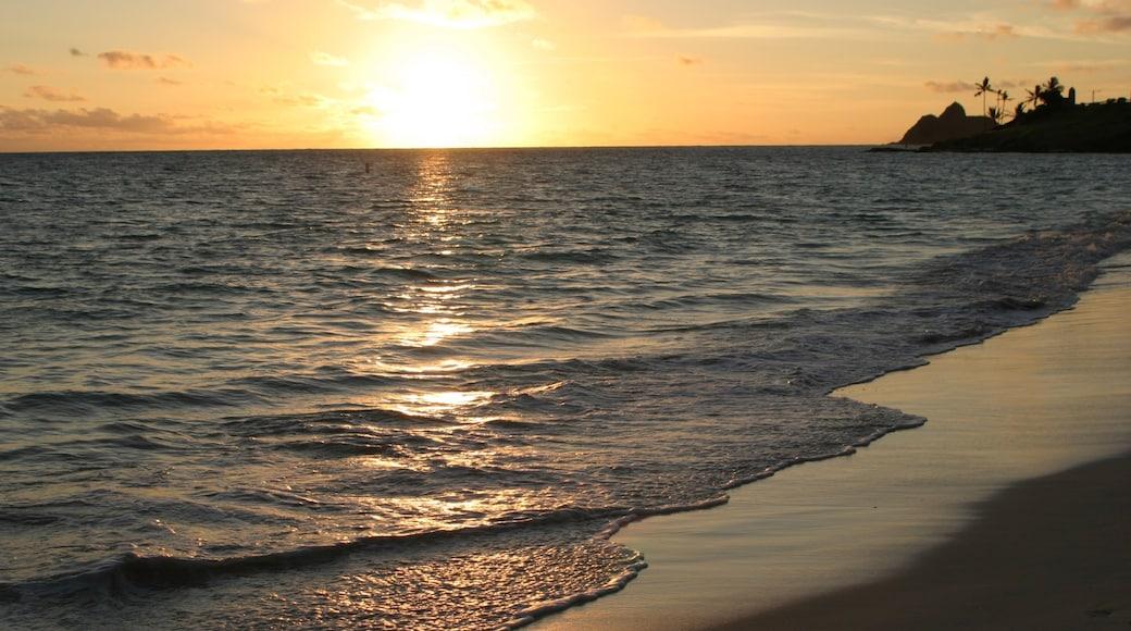 Waimanalo Beach featuring a sandy beach, a sunset and landscape views