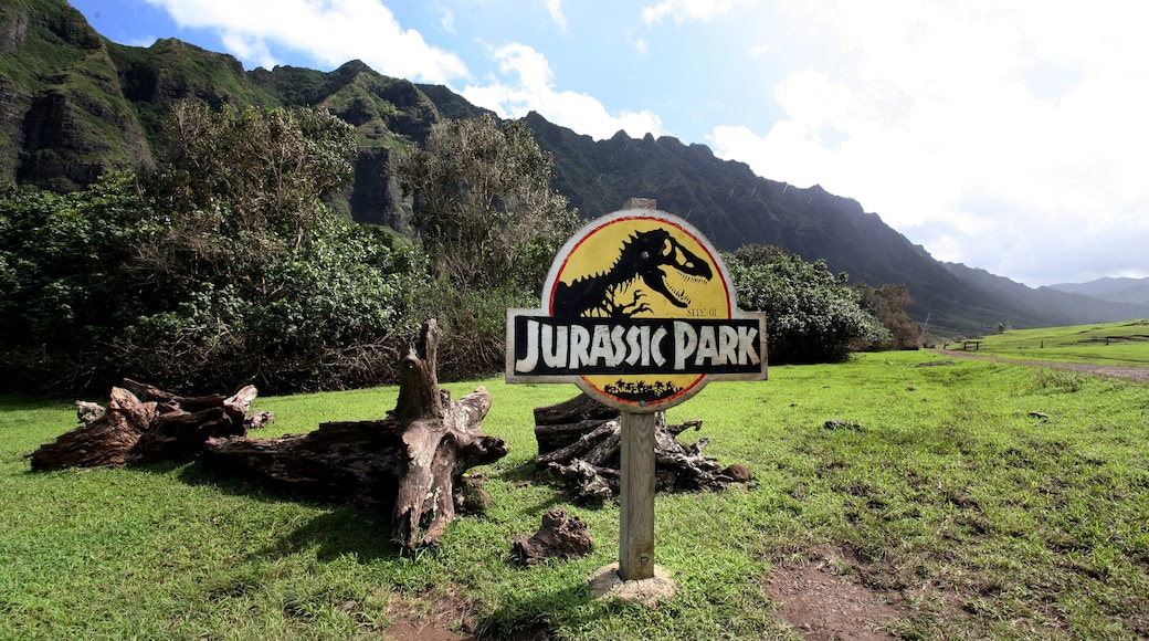 Kualoa Beach Park featuring signage, landscape views and mountains