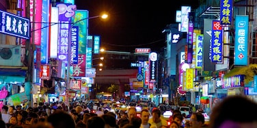 Shilin Night Market which includes night scenes, shopping and signage