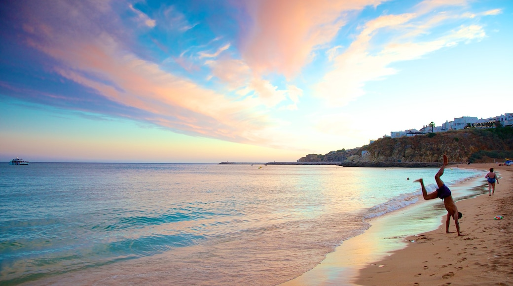 Albufeira which includes a sandy beach and landscape views as well as an individual male