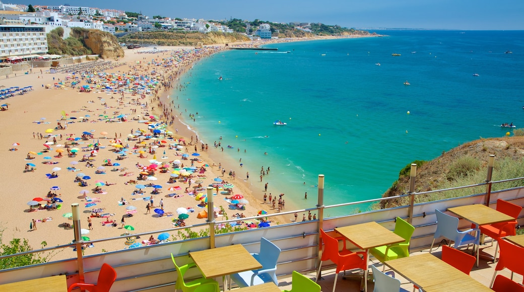 Albufeira featuring swimming, a sandy beach and a coastal town