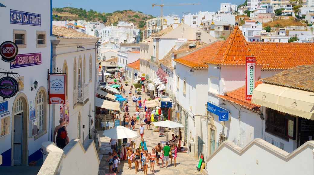 Albufeira which includes a house, street scenes and cafe scenes