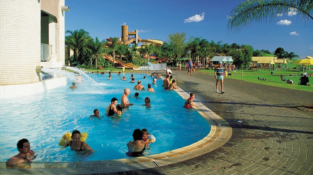 Bela-Bela featuring swimming, a luxury hotel or resort and a pond