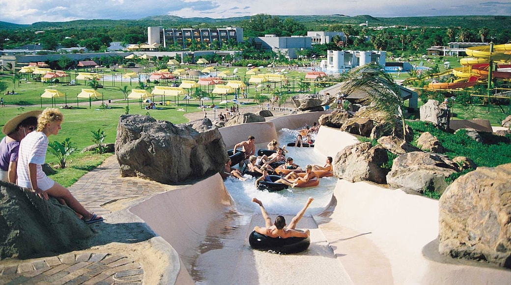 Bela-Bela which includes a water park and rides as well as a large group of people