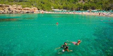 Benirras Beach which includes a sandy beach, landscape views and swimming