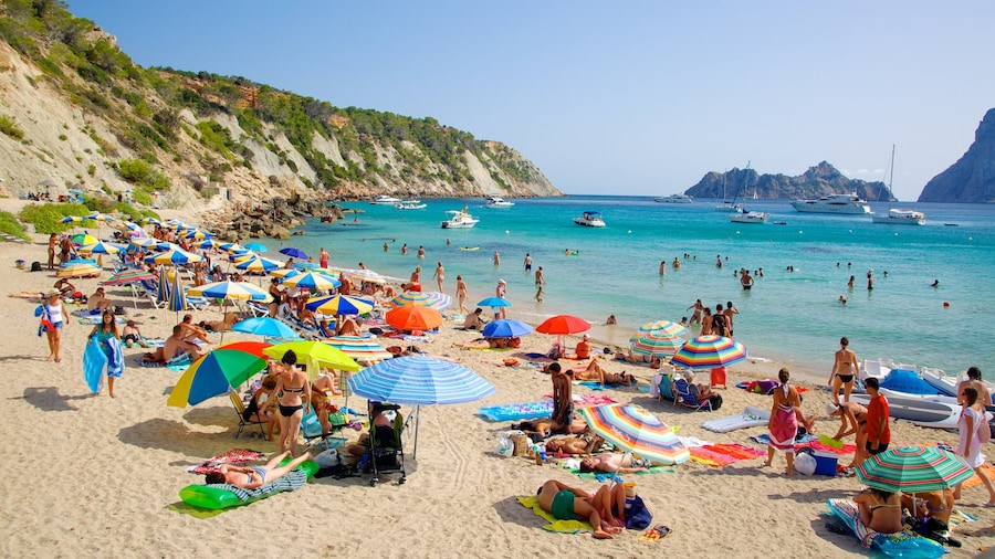 Cala d\'Hort Beach which includes a sandy beach, boating and swimming