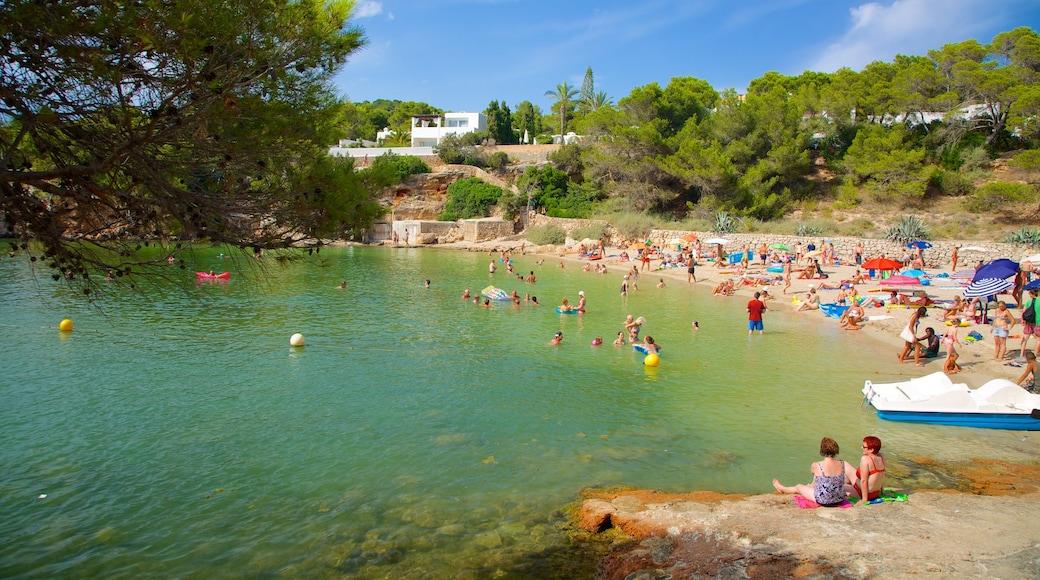Cala Gracio which includes a sandy beach, swimming and a coastal town