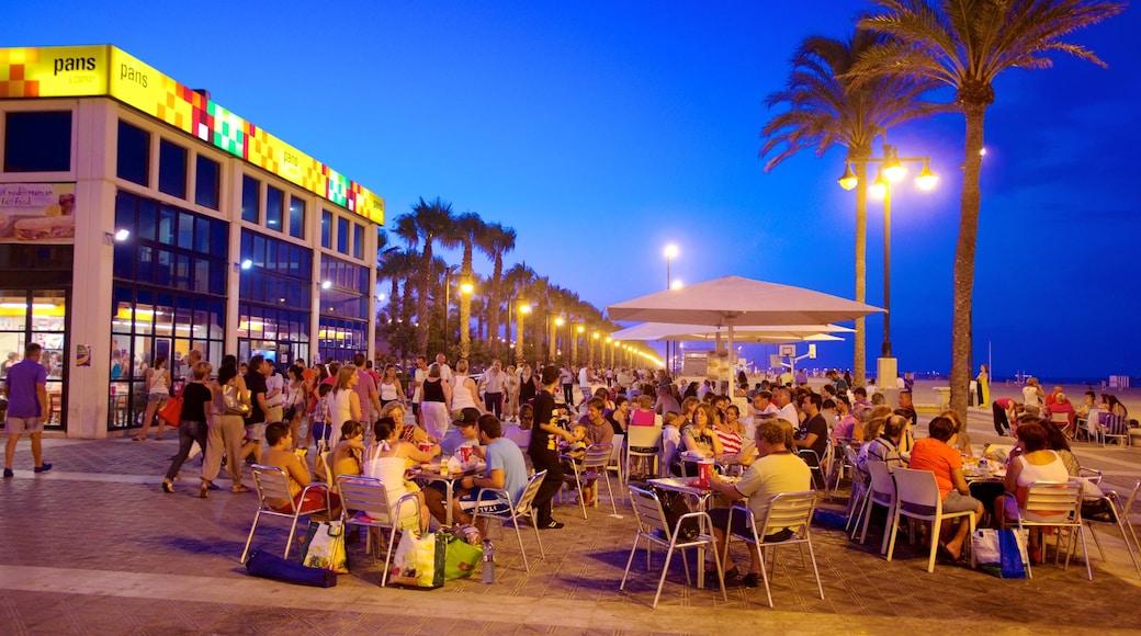 Playa de la Malvarrosa welches beinhaltet Strand, Stadt und bei Nacht