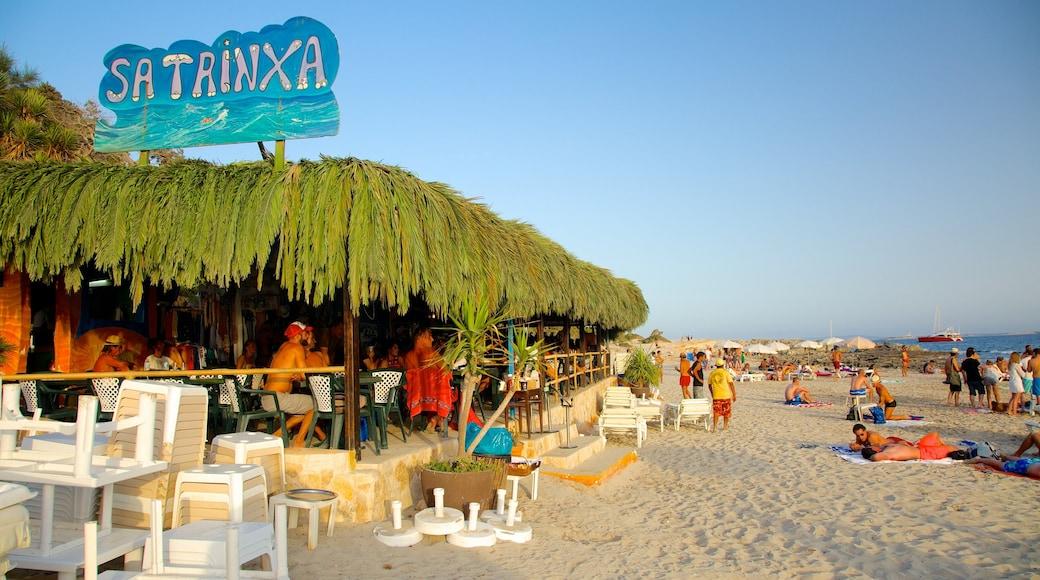 Spiaggia di Las Salinas che include spiaggia sabbiosa, segnaletica e paesaggio tropicale