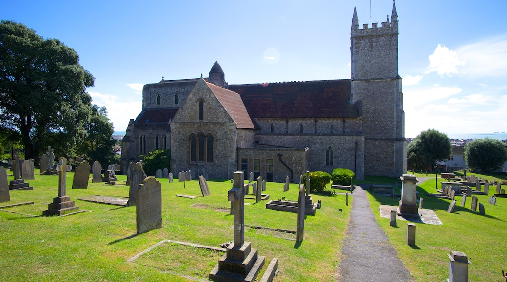Hythe showing a church or cathedral, a cemetery and château or palace