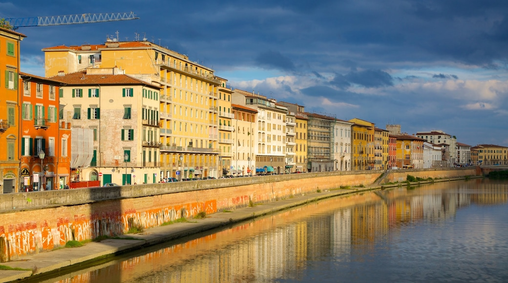 Pisa which includes a river or creek and heritage architecture