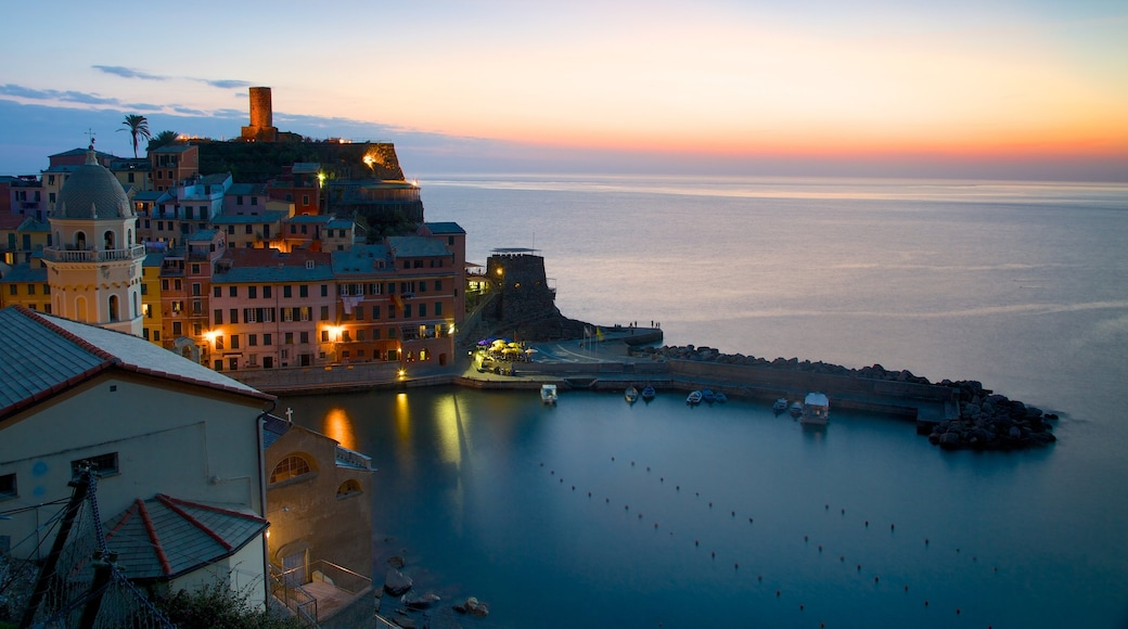 Vernazza which includes a coastal town, a bay or harbour and a sunset