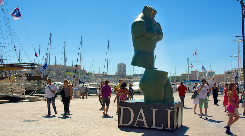 Vieux Port featuring signage, a statue or sculpture and a marina