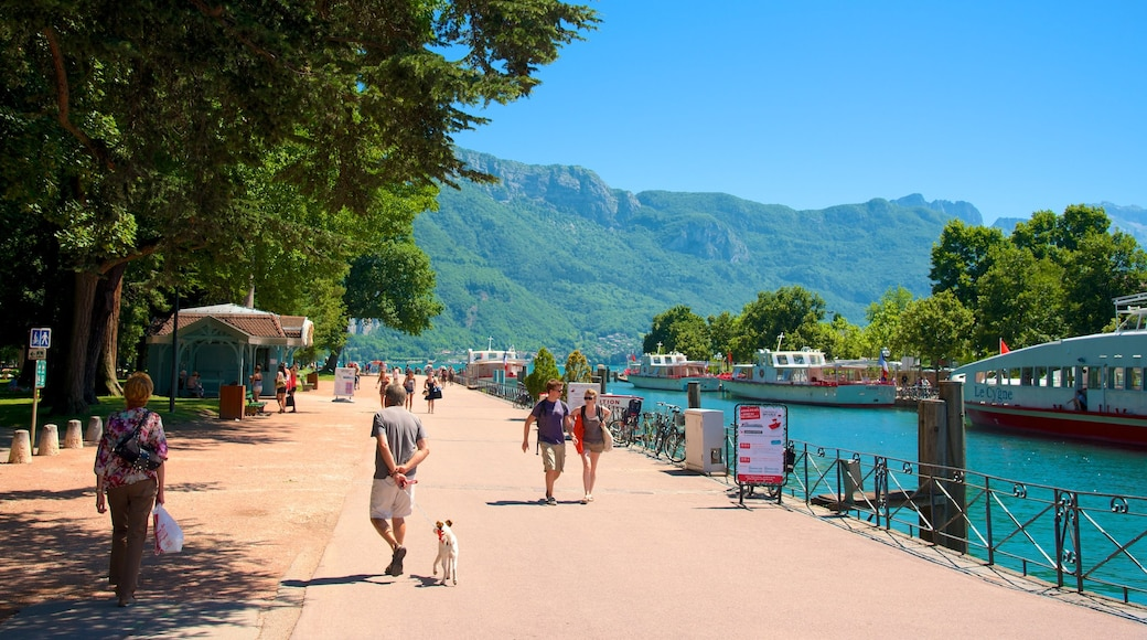 Annecy featuring a marina, boating and a river or creek