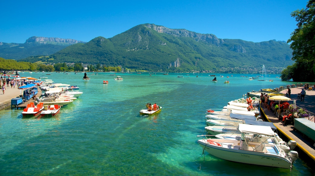 Annecy showing boating, mountains and a coastal town