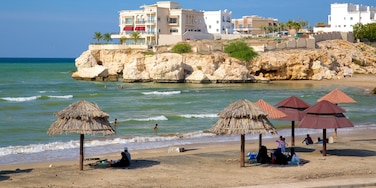 Shatti Al Qurum showing a beach, general coastal views and rugged coastline