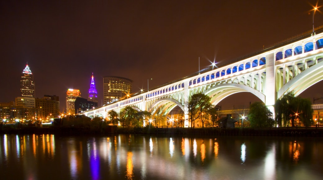 Cleveland which includes a bridge, night scenes and a city