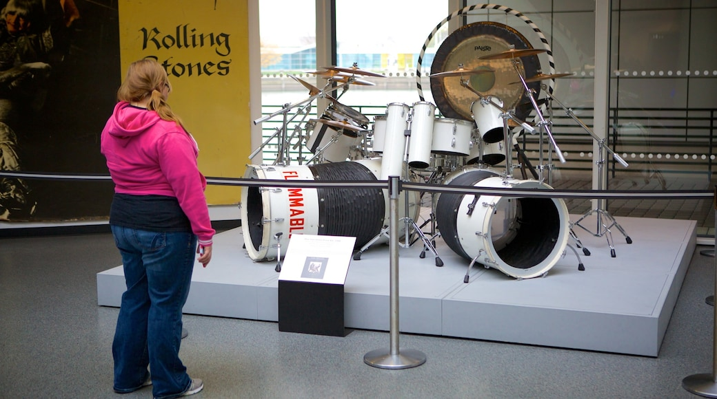 Rock and Roll Hall of Fame showing music and interior views as well as an individual female