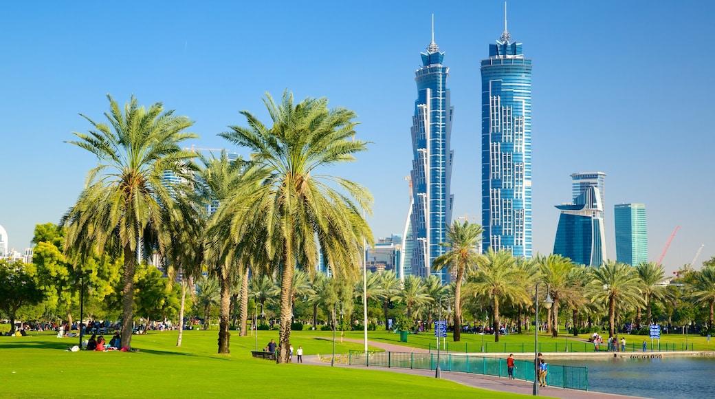 Safa Park featuring a skyscraper, modern architecture and a park