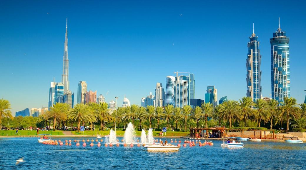 Safa Park showing a skyscraper, a garden and modern architecture