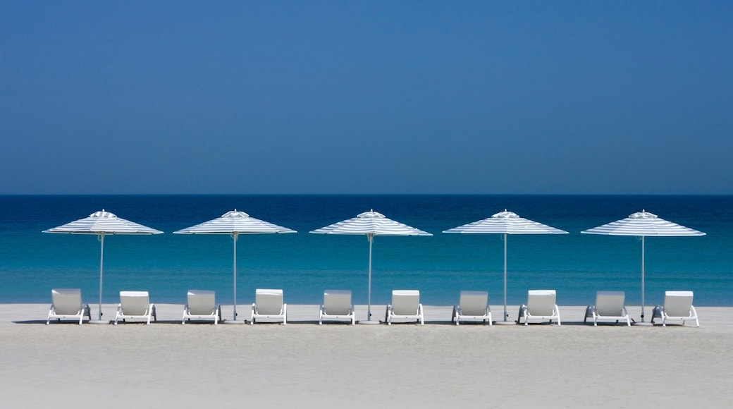 Abu Dhabi Emirate showing a sandy beach and a luxury hotel or resort