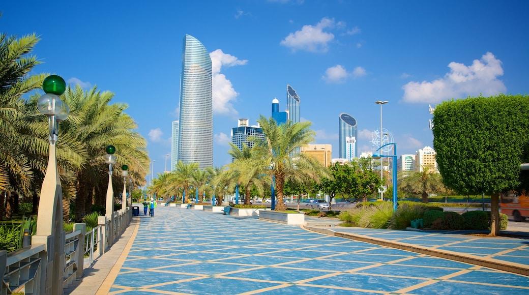 The Corniche showing modern architecture, a square or plaza and a city