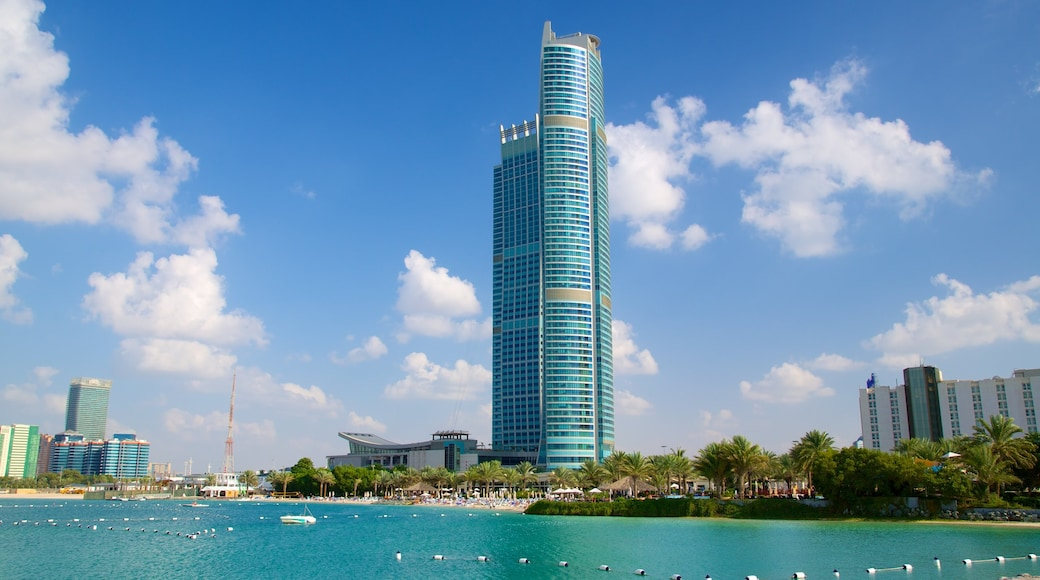 The Corniche featuring modern architecture, a bay or harbour and a high-rise building