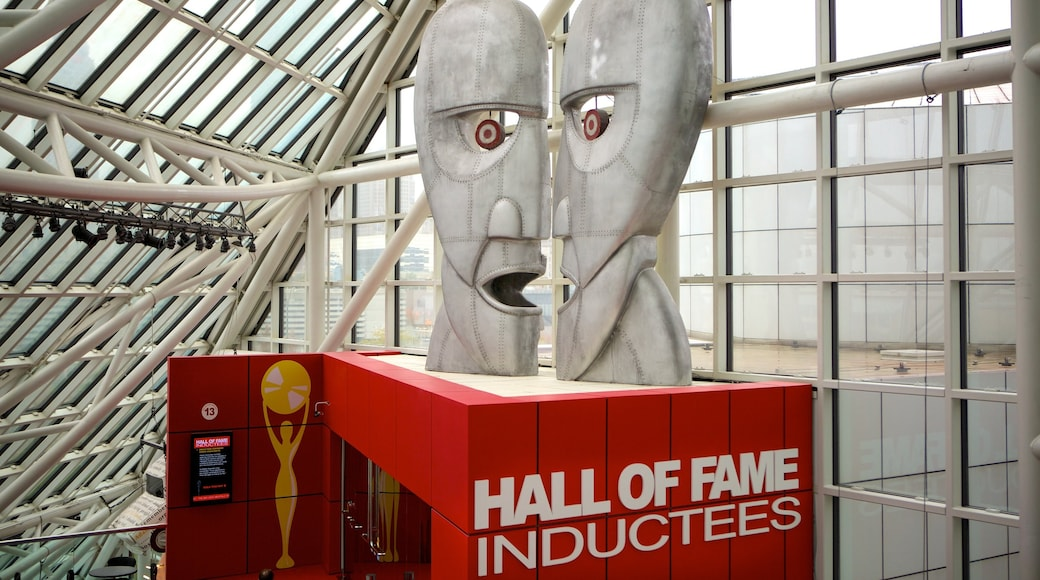 Rock and Roll Hall of Fame featuring music, interior views and signage