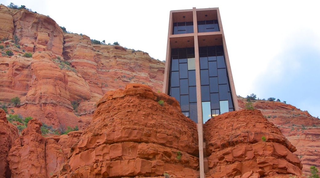 Chapel of the Holy Cross showing modern architecture, a gorge or canyon and a church or cathedral