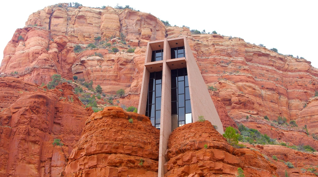 Chapel of the Holy Cross featuring a gorge or canyon, a church or cathedral and modern architecture