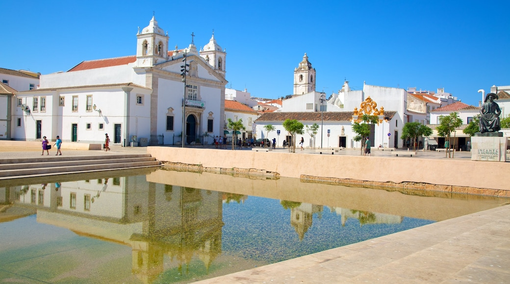 Algarve featuring a small town or village, a pool and a church or cathedral