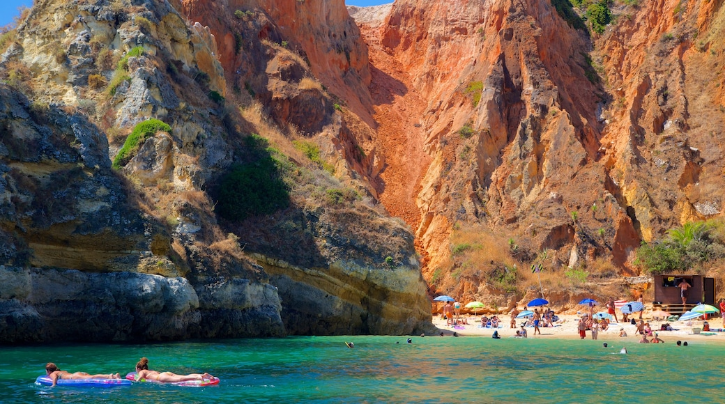 Lagos which includes a gorge or canyon, swimming and a sandy beach